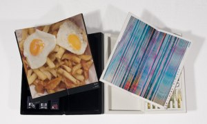 two zines opened to images of scrambled eggs and fries, and blue and pink stripes