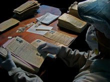 Archivist handling Guatemalan National Police Historical Archive materials